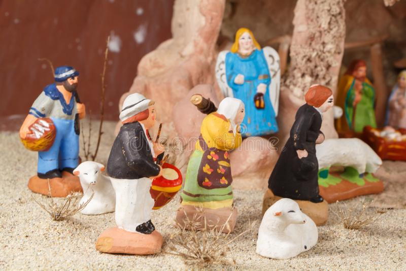 Nativity scene with provencal Christmas crib figures. Nativity scene with traditional provencal Christmas crib figures in terracotta royalty free stock photo