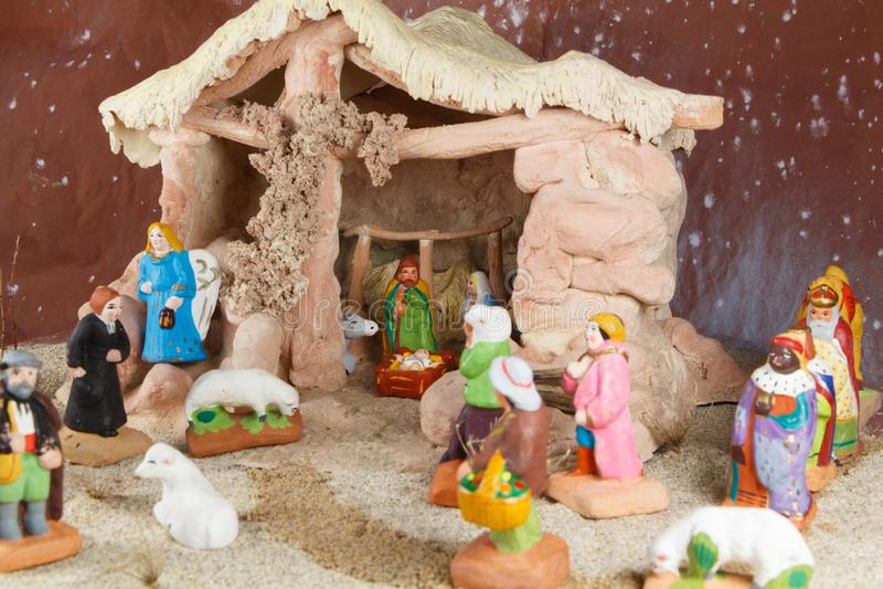Nativity scene with provencal Christmas crib figures. Traditional nativity scene with provencal Christmas crib figures in terracotta stock image