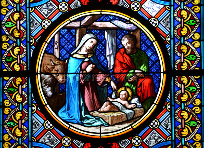 Nativity Scene. Stained glass. Window in the Basel Cathedral stock photos