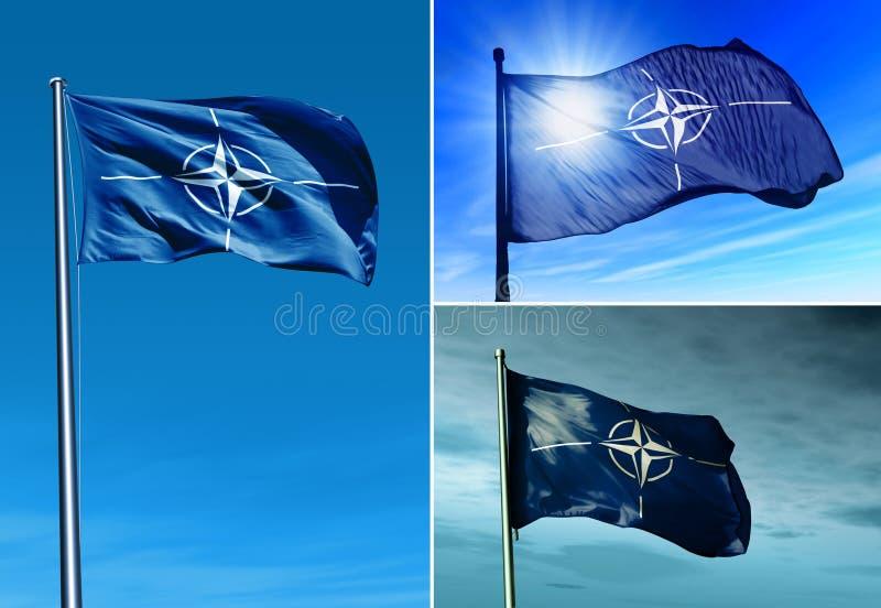 NATO flag waving on the wind stock photo