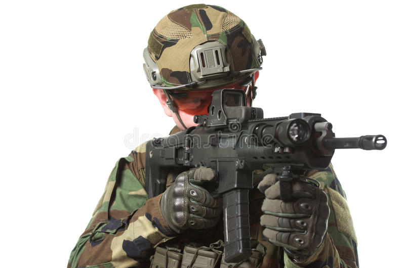 NATO soldier in full gear. Military man isolated over white background royalty free stock photos