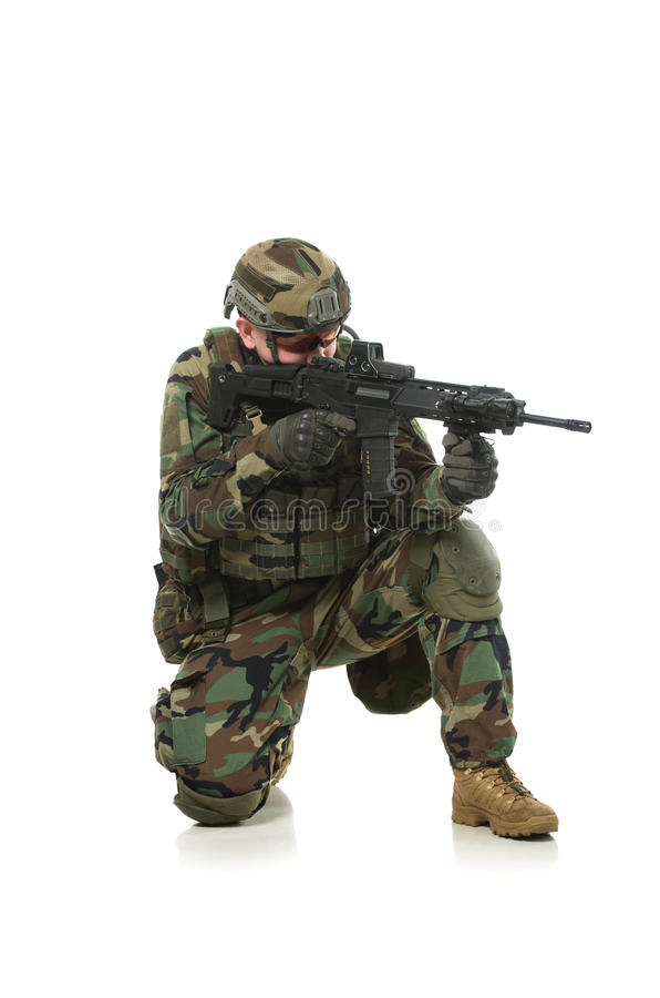 NATO soldier in full gear. Military man isolated over white background stock photography