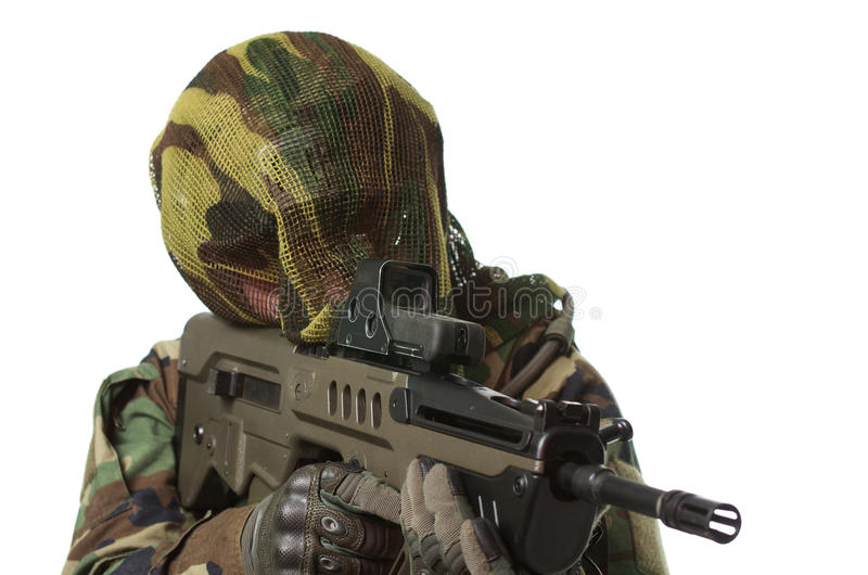 NATO soldier in full gear. Military man isolated over white background royalty free stock photo