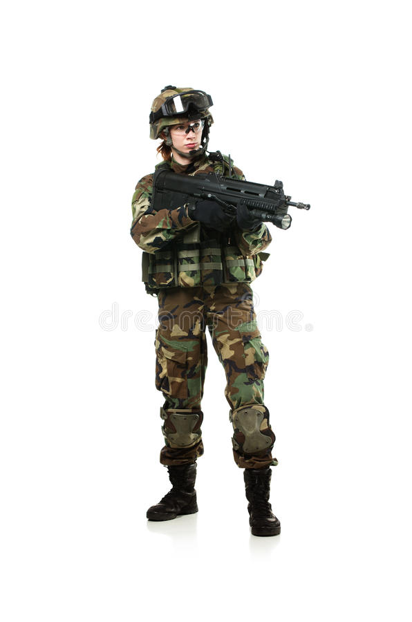 NATO soldier in full gear. Military woman isolated over white background royalty free stock photography