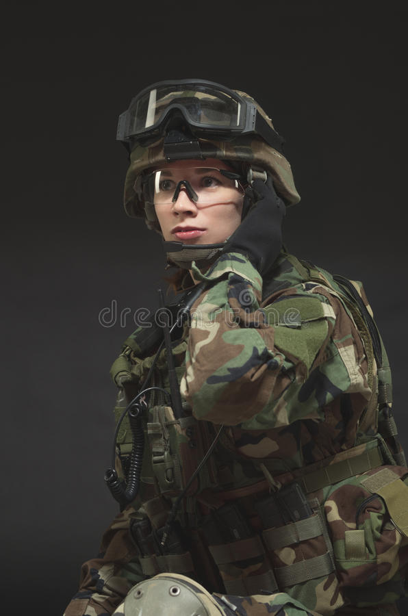 NATO soldier in full gear. Military woman over black background royalty free stock photos