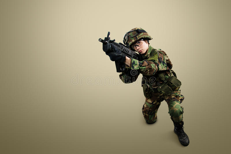 NATO soldier. Military woman over khaki background stock image