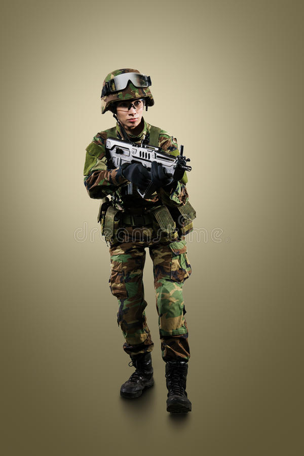 NATO soldier. Military woman over khaki background stock photography