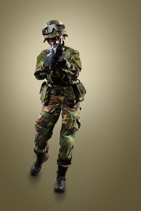 NATO soldier. Military woman over khaki background stock images