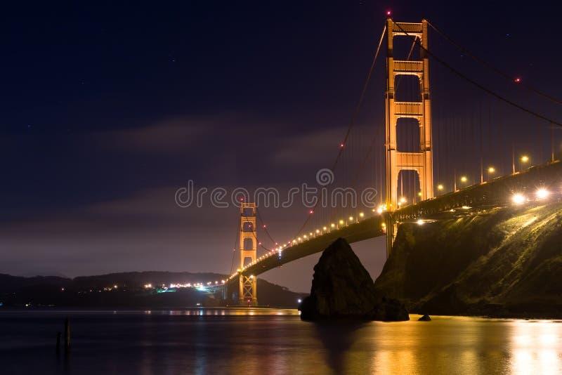 natt för port för 3 bro guld- royaltyfria foton