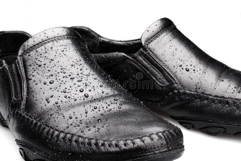 Natte Schoenen stock fotografie
