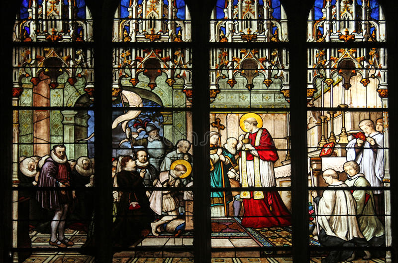 Nattvardsgång för häleri för St Aloysius Gonzaga första från händerna av helgonet Charles Borromeo royaltyfri bild
