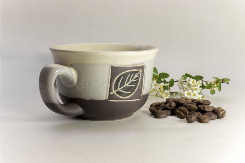 Natura morta del caffè con una tazza immagine stock