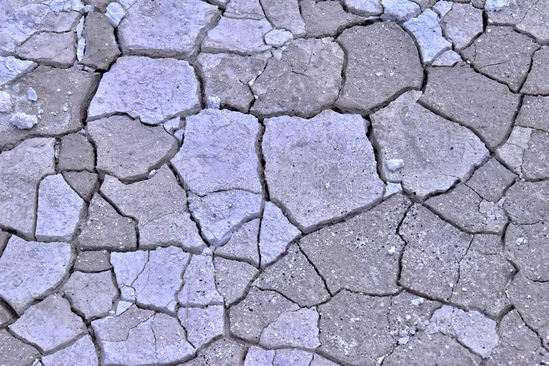 Natural abstract background texture of dried cracked bright limestone soil in turkey stock photography