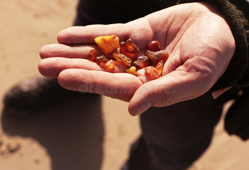 Natural amber in the palm stock images