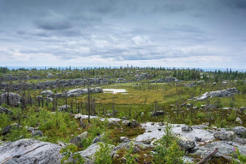The amphitheater in the nature reserve of mount Vottovaara, Karelia. A natural amphitheater, which arose after a major earthquake in the reserve mount royalty free stock image