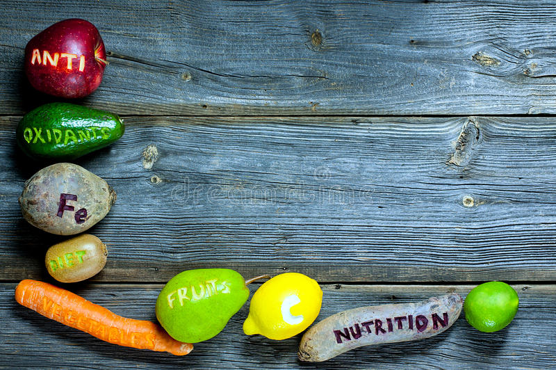 Natural antioxidants. Fruits and vegetables with cut healthy words - natural antioxidants concept royalty free stock photography