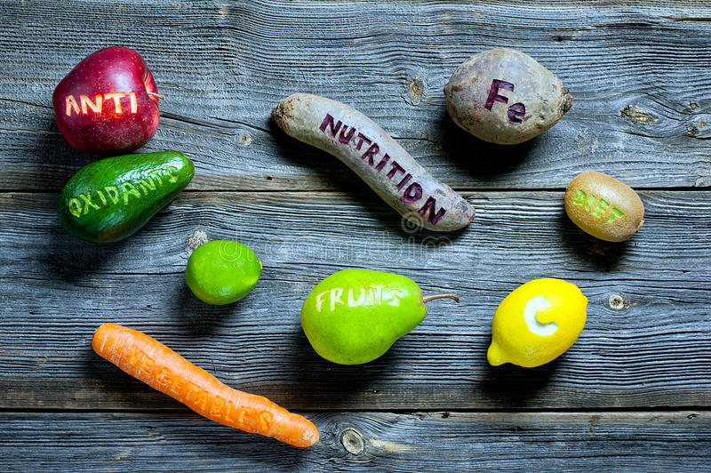 Natural antioxidants. Fruits and vegetables with cut healthy words - natural antioxidants concept stock photography