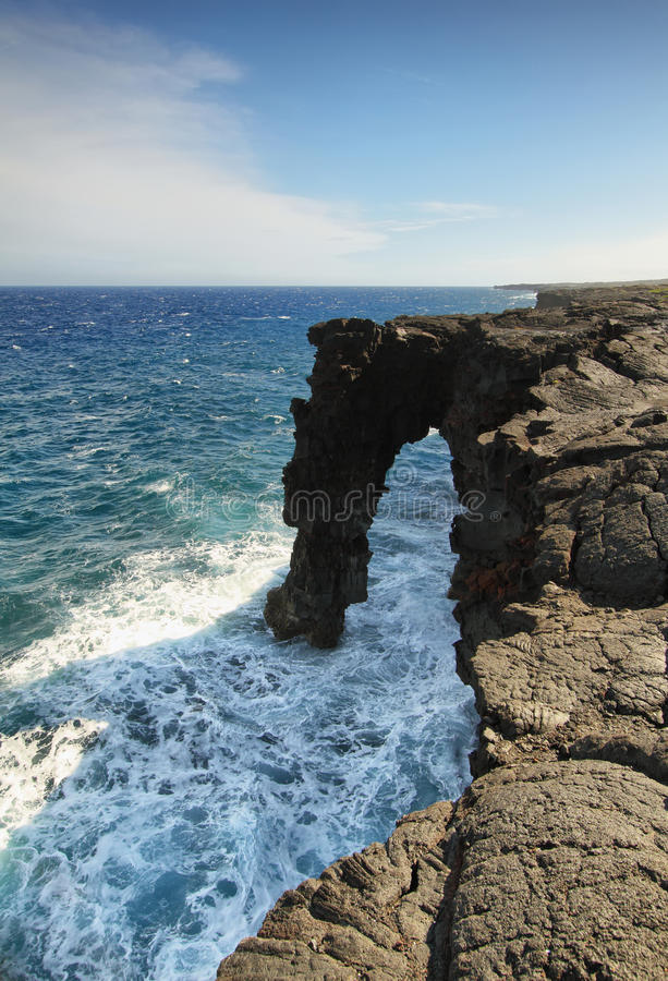 Free Natural Arch In The Black Lava Rock Cliffs Royalty Free Stock Photography - 37977637