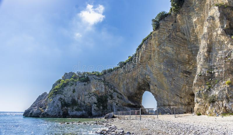 Natural arch in the rock, from Palinuro beach, Italy royalty free stock image