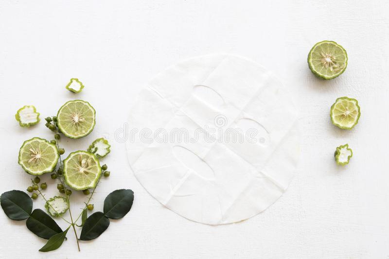 Natural aroma sheet mask from herbal kaffir lime. Natural aroma sheet mask for skin face from herbal kaffir lime essence face mask on background white royalty free stock photography