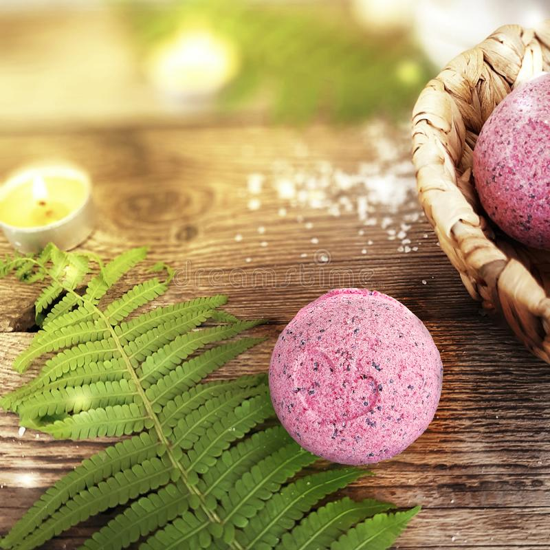 Bath bombs with fern leaf on wooden background. royalty free stock photos