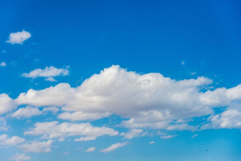 Natural background, beautiful blue sky with white clouds. Horizontal frame stock photography