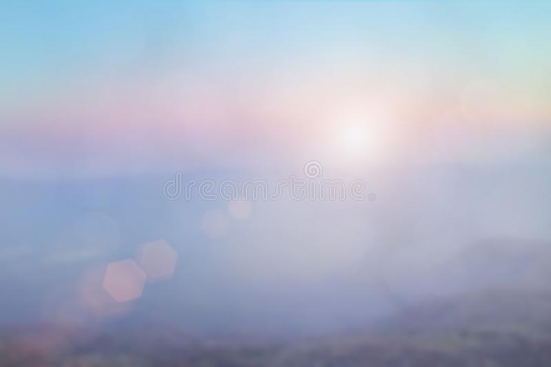Natural background blurring warm colors and bright sun light. Bokeh or Christmas background Green Energy at sky sunny color orange stock photos