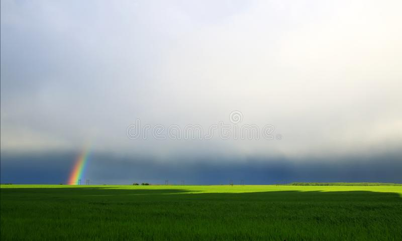 natural background with bright colorful rainbow in the distan royalty free stock image