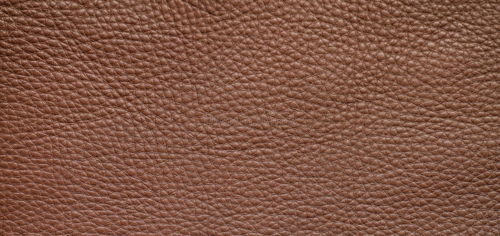 Natural background with brown leather of a rough texture. Abstract leather texture royalty free stock photos