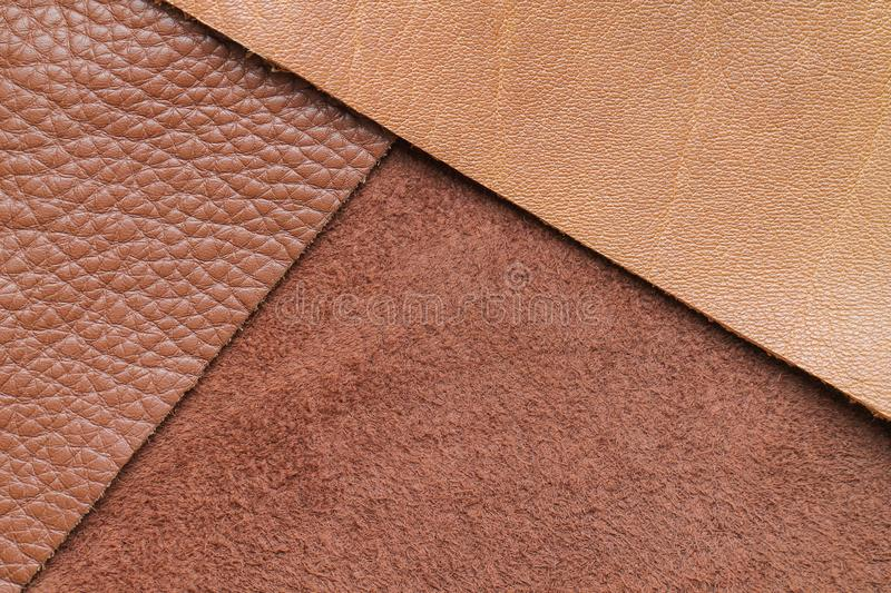 Natural background with brown leather of a rough texture. Abstract leather texture royalty free stock photography