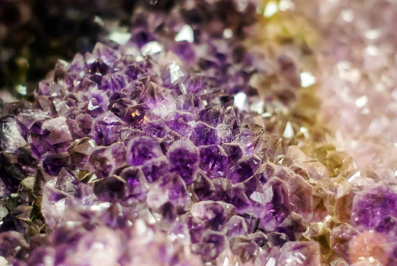 Natural background - cluster of violet amethyst crystals royalty free stock photography