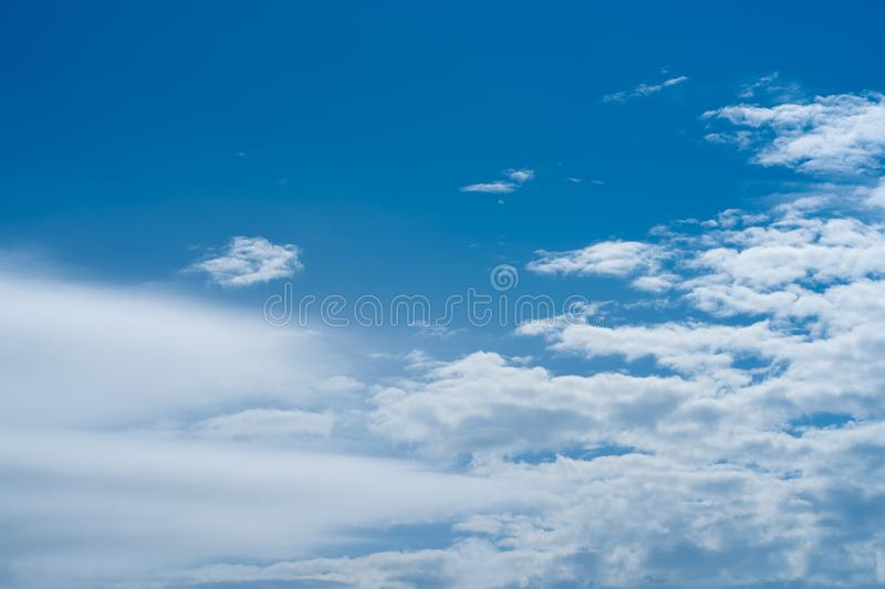 Natural background. Image of the blue sky with soft clouds royalty free stock photo