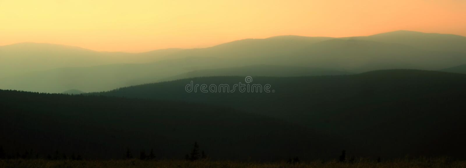 Natural background panorama background of scenic hilly landscape at dusk stock photo