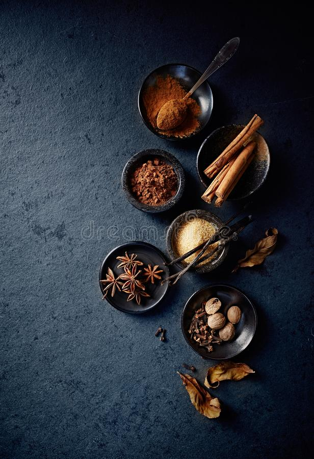 Natural baking ingredients on black stone background royalty free stock image