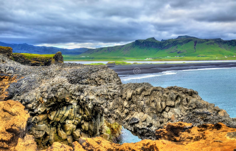 Natural basalt arch at Dyrholaey Cape - Iceland stock photos