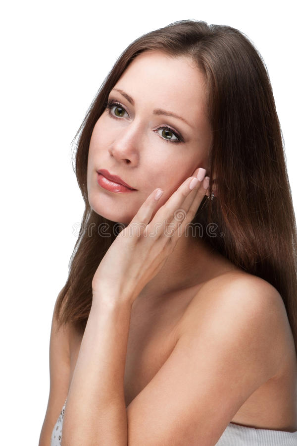 Natural beauty. Beautiful young woman touching her face isolated on whire background royalty free stock photos