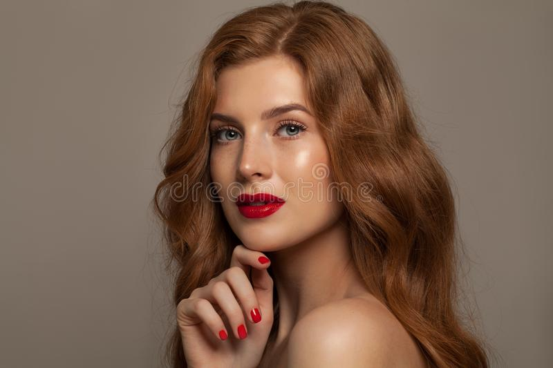 Natural Beauty. Beautiful Redhead Woman with Long Red Hair royalty free stock photos