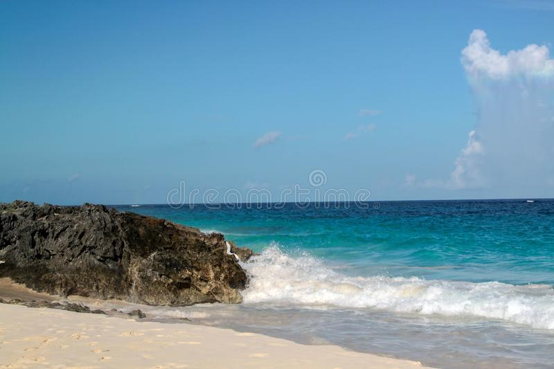Natural beauty of Bermuda.  Amazing view on a pink sand beach,  stone landscape and blue ocean stock photos