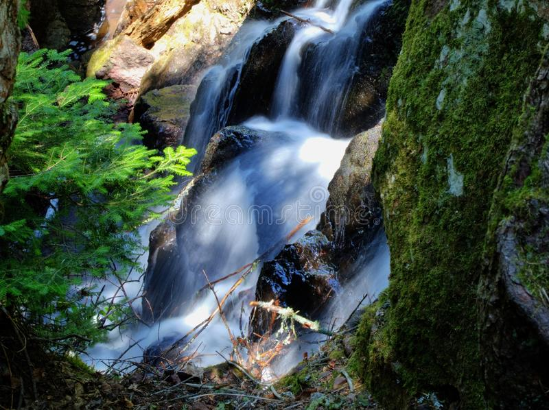 Natural Beauty. Close up a small waterfall as it splashes through a ravine. Copper Harbor, Michigan royalty free stock images
