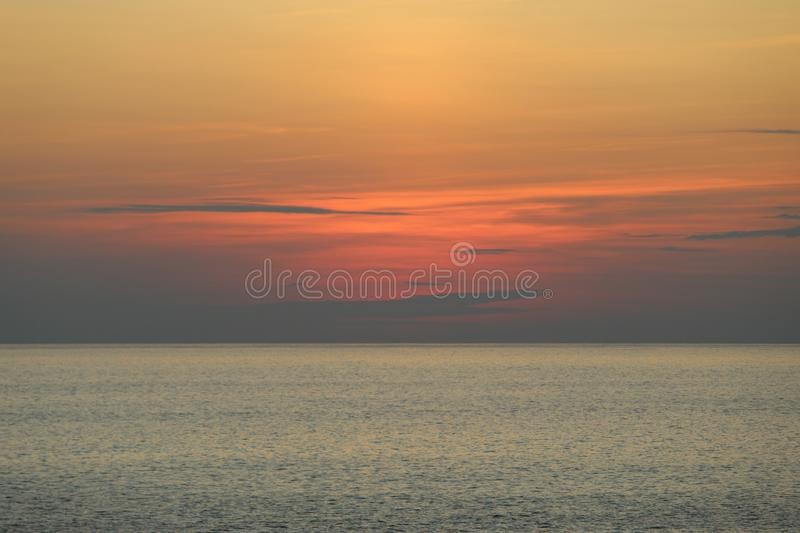Natural beauty with the colors of the sky at dusk. Sunset sky colors over sea water in a tropical destination, light, nature, ocean, travel, summer, sunlight royalty free stock photography