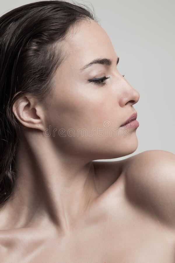 Natural beauty concept young woman  profile  face closeup studio shot royalty free stock images