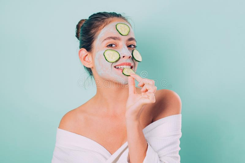 Natural beauty. Girl chilling making clay facial mask with cucumber. Skin health. Woman adorable pretty smiling girl royalty free stock photos