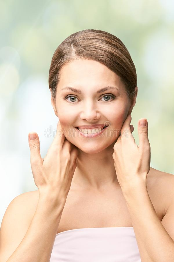 Natural beauty portrait with hands. Cosmetology mature woman face. Cosmetic cream. Skin care. Elegant girl royalty free stock photo