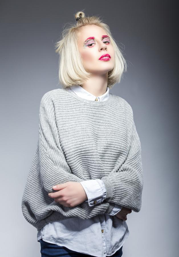 Natural Beauty portrait of Young Caucasian Blond Woman Posing in Grey Sweater royalty free stock image