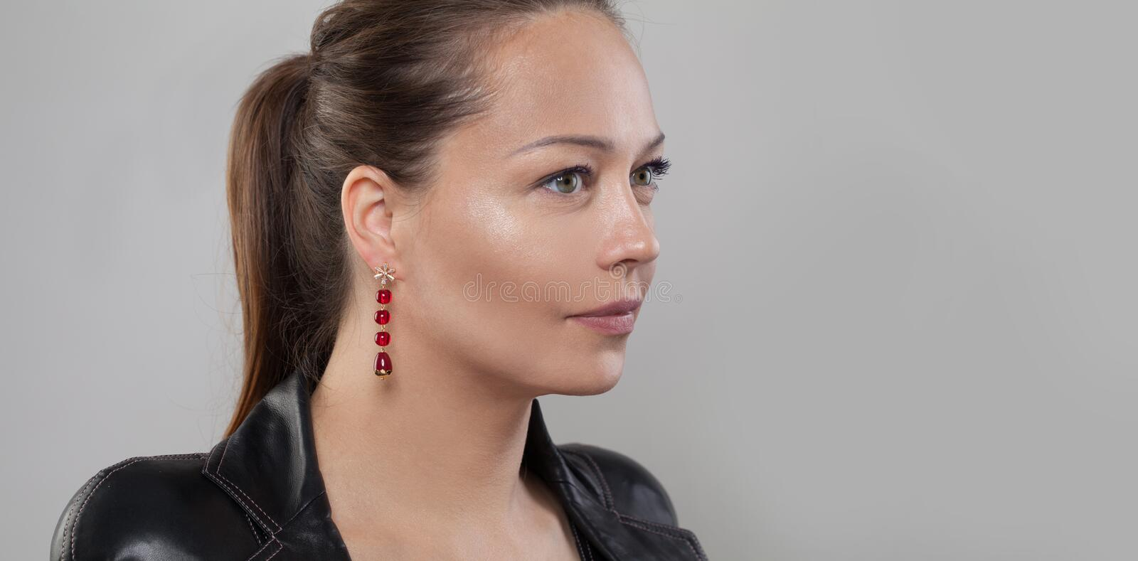 Natural beauty. Pretty face closeup. Healthy model with perfect natural clear skin. Profile.  stock images