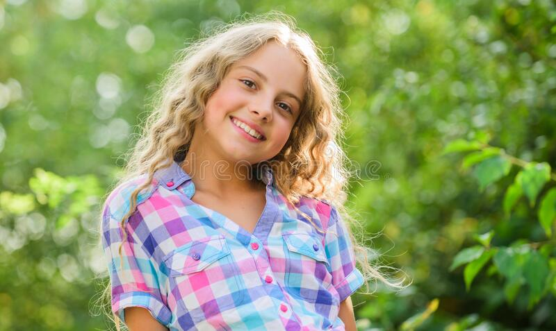 Natural beauty. small girl long culry hair. happy childhood. perfect healthy skin. youth is brilliant. summer holidays. And vacation. enjoy good weather. kid stock photos
