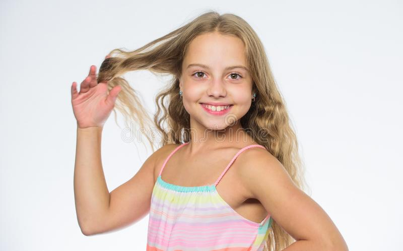 Natural beauty. Teaching your child healthy hair care habits. Hair care tips for kids. Kid little girl happy look at. Camera. How to care for childs hair. Girl royalty free stock image
