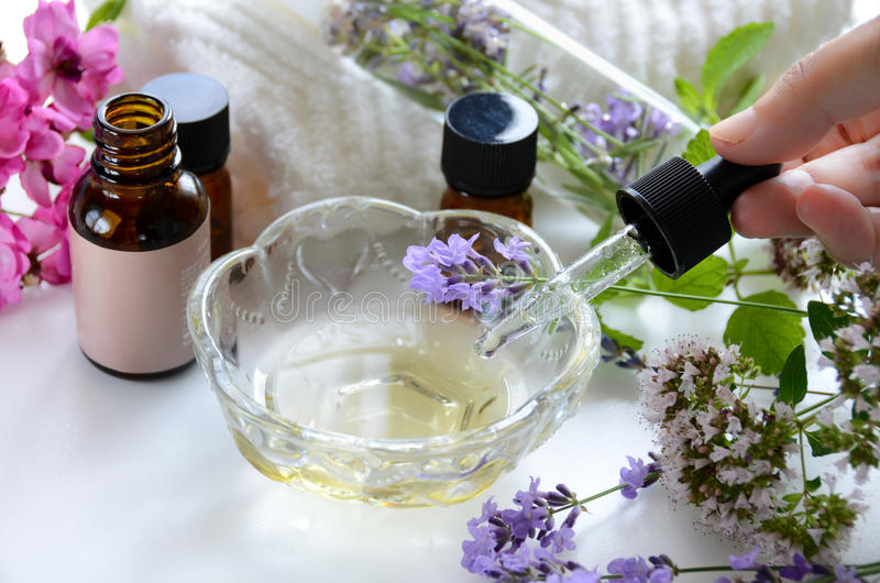 Natural beauty treatment with essential oils. Natural beauty treatment with essential oil and herbal cosmetics stock images
