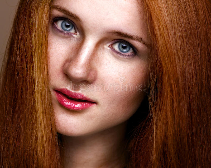 natural beauty vertical portrait of a ginger girl stock photo