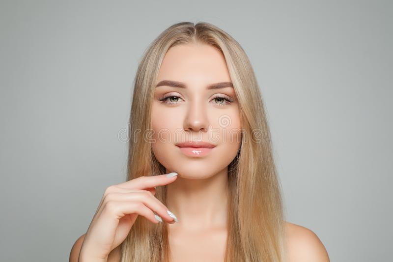 Natural beauty. Young perfect woman face. Blonde hair, clear skin. Beautiful girl portrait royalty free stock image